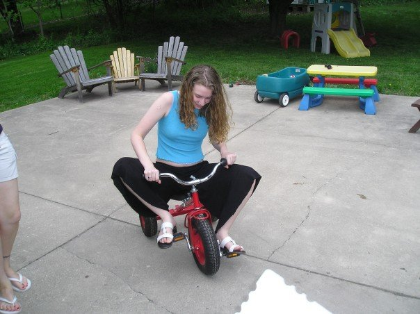 Stephonee in 2007, riding a child's tricycle