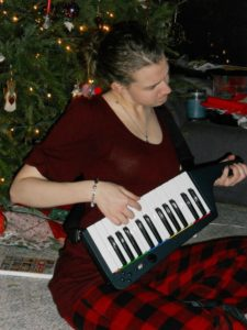 2010 Stephonee playing the video game keytar | Photo Credit: Brittney Bennett
